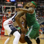 Boston Celtics guard Isaiah Thomas (right) knocks the ball from Washington Wizards forward Markieff Morris in the third quarter of Thursday's NBA second-round game at Verizon Center. The Wizards won 116-89.