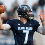 UMaine's Dan Collins looks to throw down field past New Hampshire during a November game at Alfond Stadium.