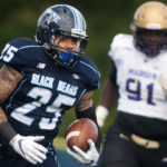 University of Maine's Darian Davis-Ray runs up field past James Madison during their football game at Alfond Stadium.