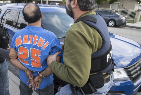 Immigration and Customs Enforcement agents take green card holder Sergio Rodriguez into custody outside his home in El Monte, Calif., on April 18, 2017.