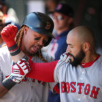 Boston's Hanley Ramirez, left, celebrates with Sandy Leon after Leon hit a two-run home run against Minnesota in the sixth inning of Sunday's game at Target Field in Minneapolis, Minnesota.