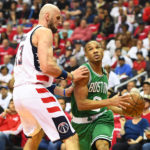 Boston Celtics guard Avery Bradley (right) dribbles against Washington Wizards center Marcin Gortat (13) during the first quarter of Sunday's NBA playoff game at Verizon Center in Washington, D.C.
