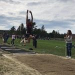 Mattanawcook Academy sophomore Cayden Spencer-Thompson soars to a leap of 47 feet, 6.75 inches in a recent high school track and field meet in Bar Harbor. Spencer-Thompson's jump is the best in state history.