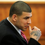 Former New England Patriots football player Aaron Hernandez sits during his murder trial at Bristol County Superior Court in Fall River, Massachusetts, on April 2, 2015. Hernandez's conviction has been thrown out by a judge after he died by suicide in April.