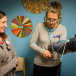 PORTLAND, MAINE -- 05/09/17 -- Nursing student Courtney Wilson checks a patient's blood pressure under the watchful eye of nurse practitioner Gretchen Speed at the Greater Portland Health clinic on Tuesday.  Wilson is graduating this month from the University of New England's accelerated nursing program. Troy R. Bennett | BDN