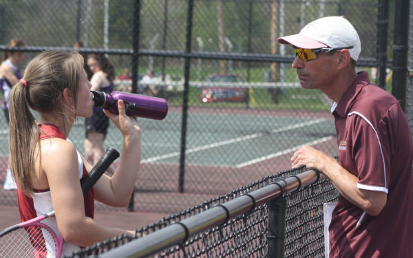 John Habeeb speaks to one of his Caribou tennis players, Ashley Matlock, during a changeover in a match this spring. Habeeb was named PVC Class B girls' coach of the year, while Matlock made the all-conference second team in singles.