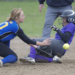 Hermon shortstop Chloe Raymond collects the ball on a throw from catcher Hailey Perry and tags out John Bapst runner Gina Cambria at second base on an attempted steal in the sixth inning of their game in Hermon on Tuesday. Hermon defeated John Bapst 6-0.