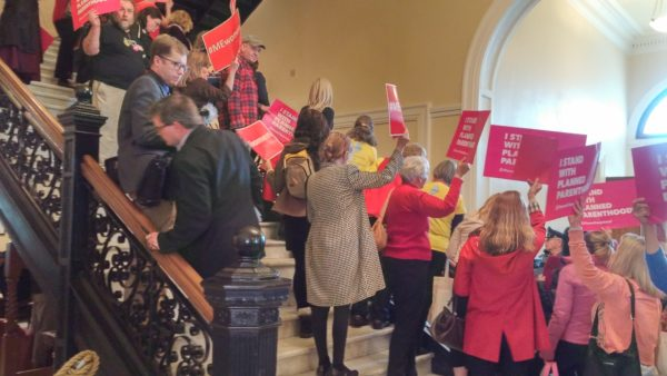 Dozens of people who were at the State House Wednesday, May 10 for Women's Day turned their focus to protesting a visit from U.S. Health Secretary Tom Price and Kellyanne Conway, a senior adviser for President Donald Trump. The protesters chanted and sang throughout a press conference with Price, Conway and Gov. Paul LePage. As Price and Conway left the State House, the protesters chanted &quotShame!&quot