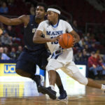 University of Maine's Wes Myers (right) drives the lane past University of New Hampshire's Jaleen Smith at the Cross Insurance Center in Bangor in January.