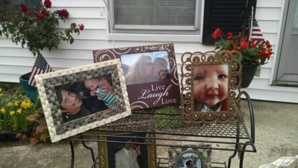 Photographs of Otto Morales-Caballeros, his wife Sandra Scribner Merlim and her grandchild were displayed Wednesday as Merlim announced that her husband will soon be deported to Guatemala.