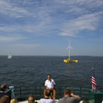 Habib Dagher, director of UMaine advanced structures and composites sector, speaks to the crowd during a trip to celebrate the first year of the University of Maine's floating wind turbine.