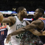 Boston's Marcus Smart (left) works the ball against Washington Wizards's Ian Mahinmi during the second half in game five of the second round of the 2017 NBA Playoffs at TD Garden in Boston on Wednesday. The Celtics defeated the Wizards 123-101. 