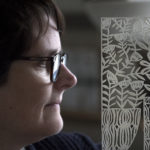 Jennifer Judd-McGee is an Northeast Harbor-based paper artist cutting intricate designs and scenes into paper.