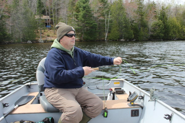 Rob Dunnett feeds out line while fishing on Toddy Pond in Orland recently. Come spring and fall, Dunnett likes to focus his fishing efforts on trolling with streamer flies.