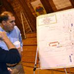 Wiscasset downtown business owner Jay McNamara (left) reviews a diagram of the downtown parking proposal with Maine Department of Transportation Project Manager Ernie Martin on Monday.