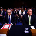 Acting FBI Director Andrew McCabe and Central Intelligence Agency Director Mike Pompeo testify before the U.S. Senate Select Committee on Intelligence on Capitol Hill in Washington.