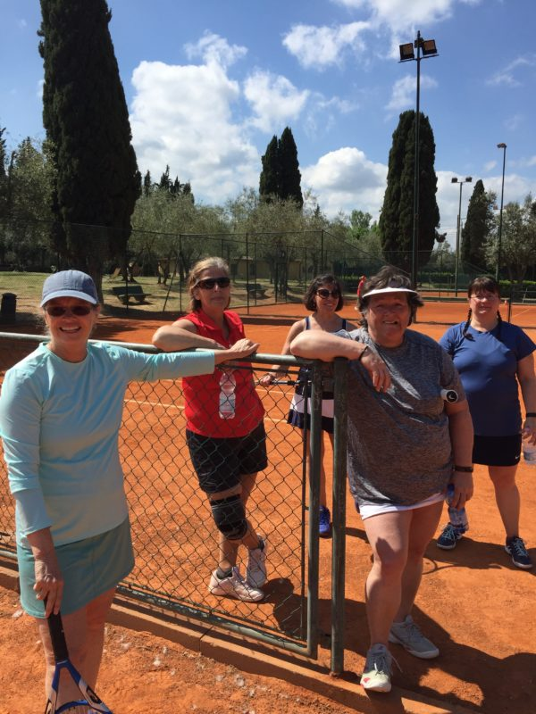 Members of the Ellsworth Tennis Center pose recently on the red clay courts of the Match Ball Firenze Country Club in Florence, Italy. From left to right: Anne Gibson, Karen Robidoux, Teri Green, Sandy Johnson, Andrea Maloney