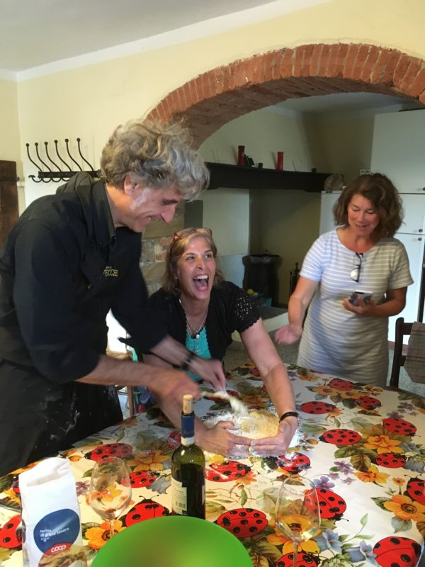 In the kitchen of their villa in the Tuscan hills, chef Gabriele Fratini (left), Karen Robidoux of Ellsworth and Sarah Maxwell of Southwest Harbor enjoy a lesson in preparing fresh pasta. Eight teammates from the Ellsworth Tennis Center recently enjoyed a tennis vacation together in Italy.