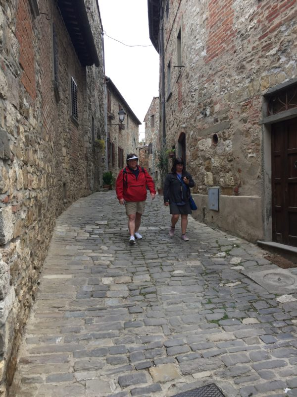 Sandy Johnson, left, of Southwest Harbor and Andrea Maloney of Ellsworth explore a cobbled street in the Medieval hill town of Montefioralle in Tuscany. The two women recently spent a week in Tuscany with their teammates from the Ellsworth Tennis Center.