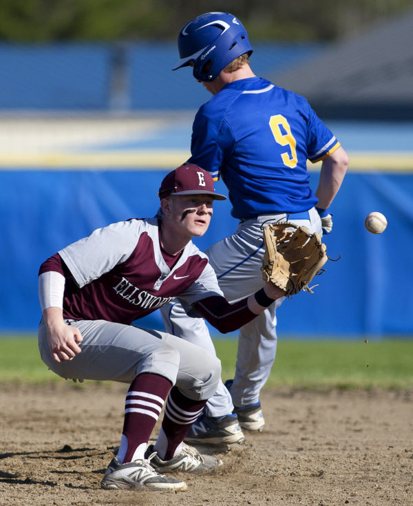Hermon's Matt Leach (right) makes it safely to second before Ellsworth's Bradly Smith can make the catch and tag during their baseball game in Hermon Friday.