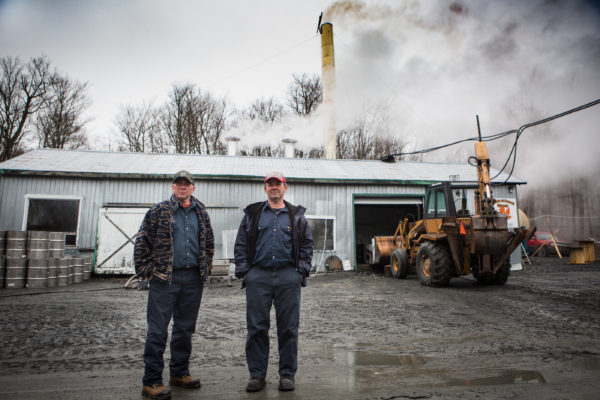 Alcide (left) and Benoit Giroux stand outside their sugar house in Big Six Township on Monday. They tap 80,000 trees each year but say they may have to close down if the landowner doesn't agree to a more fair contract.