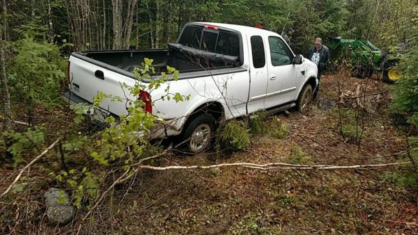Frederick Taylor, 82, is escorted to safety after he spent the night in the woods in LaGrange, where his pickup got stuck in the mud on Saturday afternoon.