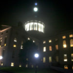 The State House shines through the the fog