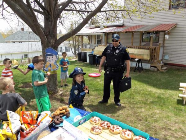 Augusta police Officer Brad Chase surprised 5-year-old Evie on Saturday for her police-themed birthday party.