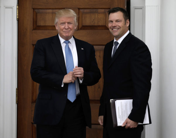 President Donald Trump, left, and Kris Kobach, the Kansas secretary of state, on Nov. 20, 2016, at the clubhouse of Trump International Golf Club, in Bedminster Township, N.J.