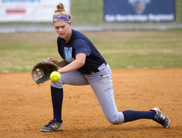 University of Maine's Alyssa Derrick snags a ball down third base during  softball practice at the University of Maine in Orono in April.