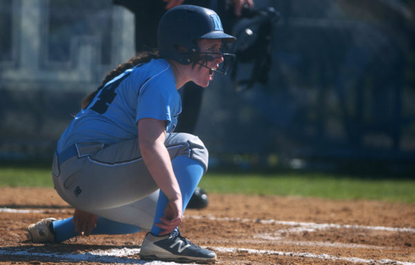 University of Maine's Meghan Royle celebrates after sliding past a University of Maryland-Baltimore County catcher in a 2016 file photo.