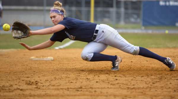 University of Maine's Alyssa Derrick lays out to snag a ball down the third base line during softball practice at the University of Maine in April.