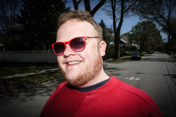 Portland comedian Connor McGrath stands on the leafy street in Deering he's called home for most of his life. McGrath's Asperger's syndrome doesn't hinder his comedy, he said, &quotIt's just like being left handed.&quot Troy R. Bennett | BDN