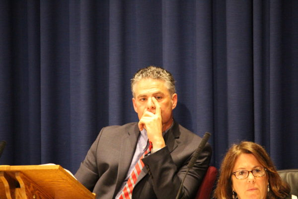 Mayor Ethan Strimling listens as the Portland city council debates eliminating the job of his assistant.