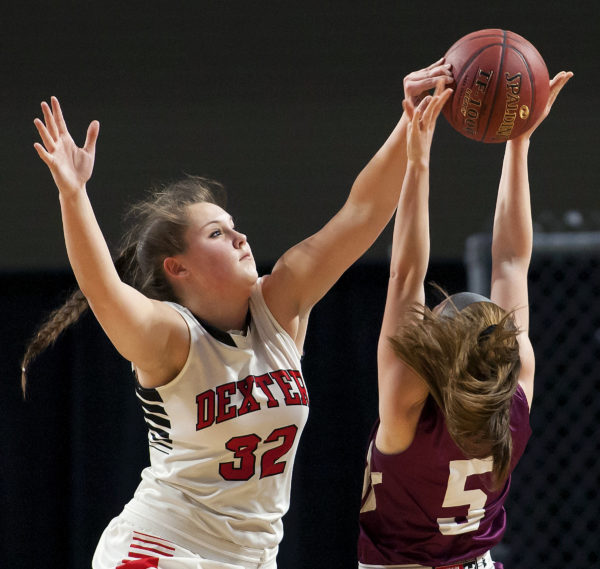 Dexter's Megan Peach (left) blocks a shot from Monmouth's Emily Grandahl during their Class C girls basketball state championship at the Cross Insurance Center in Bangor, March 4, 2017.