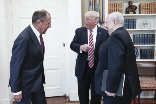From left, Russia's Foreign Minister Sergei Lavrov, U.S. President Donald Trump, and Russian Ambassador to the United States Sergei Kislyak talk during a meeting in the Oval Office at the White House on Wednesday, May 10, 2017 in Washington, D.C.