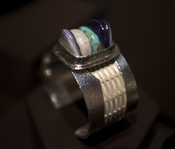 Donna Decontie Brown and her husband Jason Brown have been designing jewelry and clothing at their Bangor studio. Pictured is a bracelet made of hand-woven brown ash, argentinum silver, deer antler, wampum shell and turquoise.