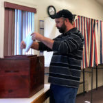 Limestone resident Tadd Devoe casts his ballot during a May 16 vote to see if Limestone residents favor withdrawing from RSU 39, and authorizing a withdrawal committee to spend up to $40,000 for the cause. Follow the developing story at thecounty.me.