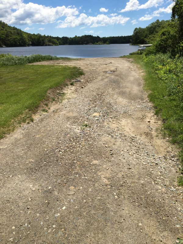 The boat launch at Hosmer Pond adjacent to the Camden Snow Bowl, as part of the new project approved by the town, will pave and raise the current boat launch to better prevent runoff into the pond. More than 30 wetland shrubs will also be planted nearby to protect against erosion.