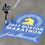 Edna Kiplagat runs down Boylston Street towards the finish line of the 2017 Boston Marathon.