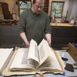 Peter Werner talks about the 1961 reprints of the Gutenberg Bible he is in the process of binding for a customer. Werner of Blue Hill is a master bookbinder who learned the craft from his grandfather, Arno Werner.