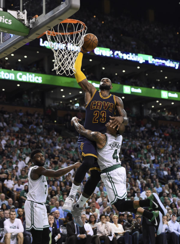 Boston's Isaiah Thomas (4) fouls Cleveland's LeBron James during the second half in Game 1 of the NBA's Eastern Conference finals at TD Garden on Wednesday night.