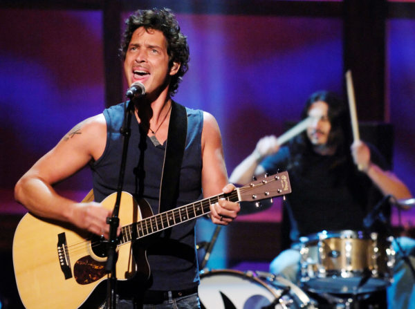 Chris Cornell (L) and Brad Wilk of music group Audioslave perform live during the &quotReAct Now: Music & Relief&quot special at Paramount Studios in Los Angeles, Sept. 10, 2005.