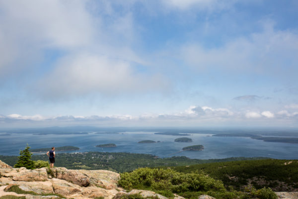 Tourists explore the southwest side of Cadillac Mountain on a sunny summer day in July of 2016.