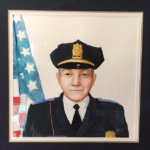 A portrait of former Bath Police Sgt. Merle Niles, painted by local artist Benjamin Glick.