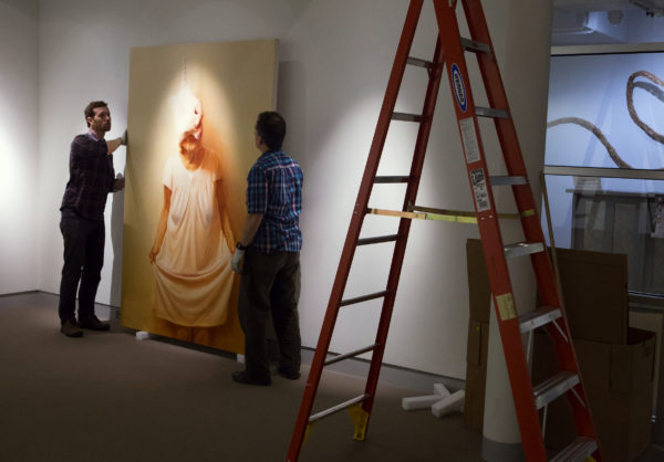 Shawn Lefevre (left) and Aaron Pyle work to install the work of New York-based artist Jason Bard Yarmosky at the University of Maine Museum of Art in Bangor Thursday.
