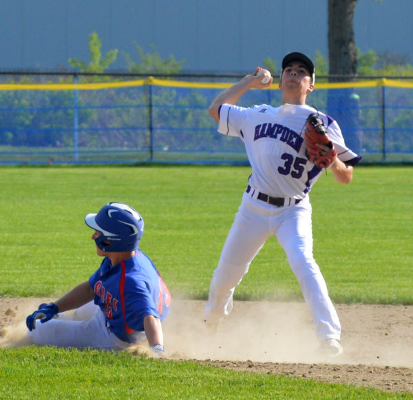 Gavin Partridge of Hampden Academy throws to first base to turn a double play as Mt. Ararat's Nate Leslie slides into second during Thursday's game in Topsham. 