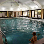 A resident relaxes in a swimming pool at The Thatchers Holiday Village in Modbury Devon, Britain April 12, 2017.