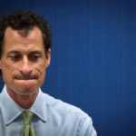 Former U.S. congressman from New York and current democratic candidate for New York City Mayor Anthony Weiner listens to fellow candidates speak at a debate held at the Museum of Tolerance in New York, U.S. on August 14, 2013.