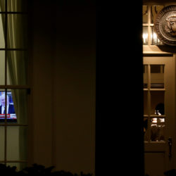 A television plays a news report on U.S. President Donald Trump's recent Oval Office meeting with Russia's Ambassador to the U.S. Sergei Kislyak as night falls on offices and the entrance of the West Wing of the White House in Washington, U.S. May 15, 2017.